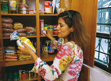 woman checking food for emergency preparedness